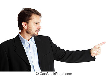 Mature businessman pointing at copyspace, isolated over white background
