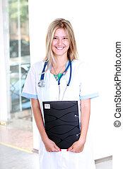 blond medical doctor woman with stethoscope Isolated over...