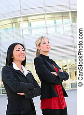 Pretty Business Women at Office - A diverse business woman...