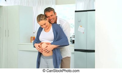 Lovely future parents in the kitche
