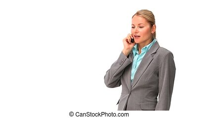 Relaxed business woman speaking on the phone against a white...