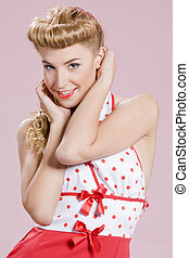 pin-up girl - a beautiful inocent pin-up girl over a pink...