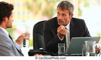 Businessmen during a meeting talking about a new project