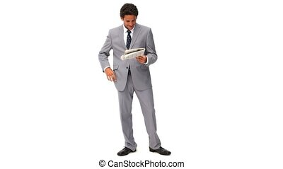 Elegant business man reading a newspaper isolated on a white...