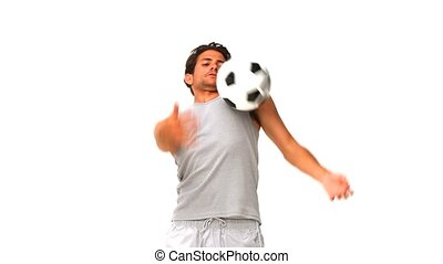 Man playing with a soccer ball isolated on a white...