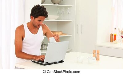 Relaxed man enjoying his chat on his laptop