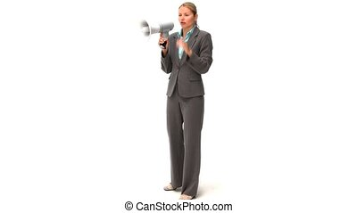 Business woman giving orders through a loudspeaker