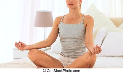 Blonde woman doing exercise of relaxation