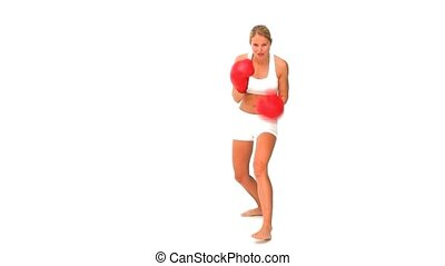 Woman with red boxing gloves in sportswear isolated on a...