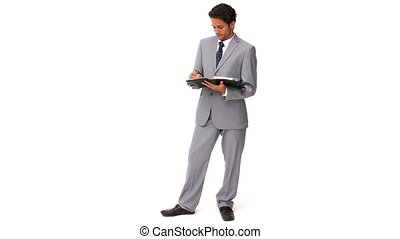 Elegant business man taking notes isolated on a white...