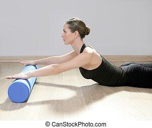 blue foam roller pilates woman sport gym fitness yoga wood...