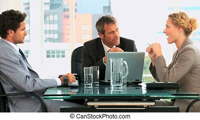 Threesome business meeting in an office