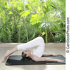 black mat yoga woman window rainforest jungle view - black...