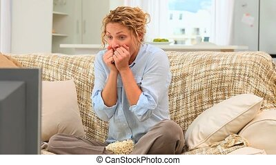 Stressed woman watching a match