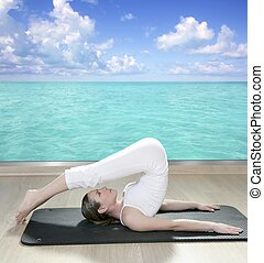 black mat yoga woman window turquoise sea view tropical...