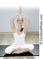 yoga woman fitness girl in white meditation at gym on mat