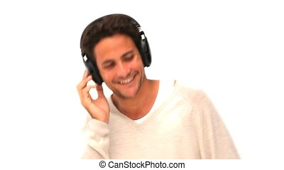 Handsome man dancing with headphones