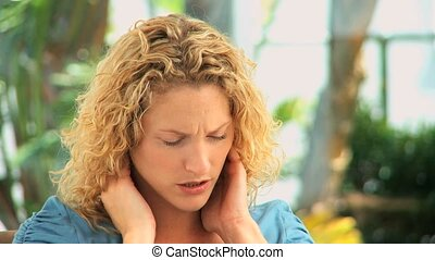 Curly haired woman having a neck pa