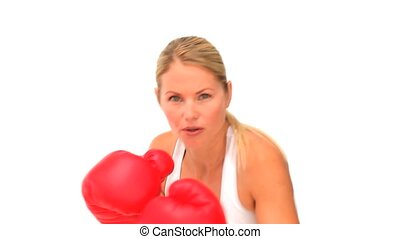 Dynamic woman with red boxing gloves isolated on a white...