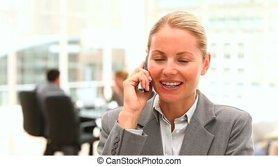 Business woman having a call during a meeting