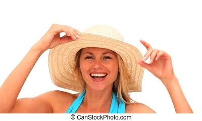 Attractive blonde woman with an hat in swimsuit