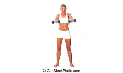 Woman in sportswear with dumbbells