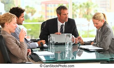 Four people during a business meeting in an office