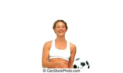 Woman playing with a soccer ball isolated on a white...