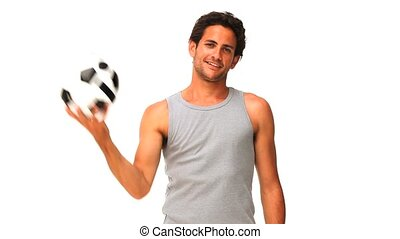 Handsome man with a soccer ball isolated on a white...