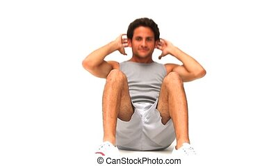 Handsome dark haired man sitting-up isolated on a white...
