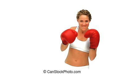 Curly haired woman with boxing gloves isolated on a white...