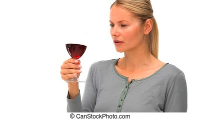Casual blonde woman enjoying a glas