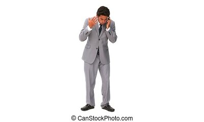 Elegant business man getting nervous on the phone isolated...