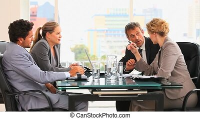 Four people during a meeting in an office