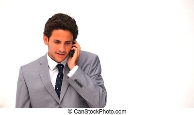 Elegant business man talking on the phone againsta a white...