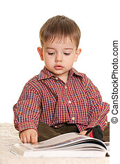 Young learner at the book - A closeup portrait of a handsome...