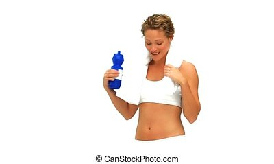 Blonde woman after sports with a towel and flask