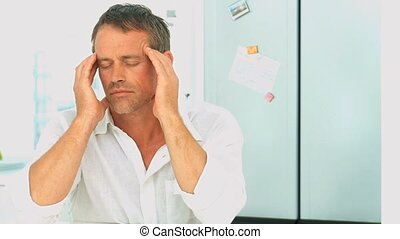 Middle aged man having an headache