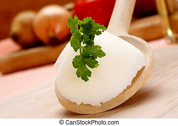 Lard with parsley on a wooden spoon