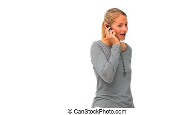 Casual blonde woman speaking on the phone isolated on a...