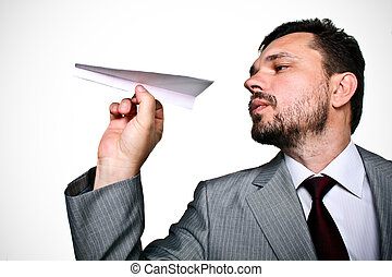 Mature business man throwing a paper plane