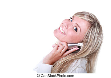 attractive young blonde woman calling by cell phone