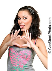 Lovely young woman shows heart with her hands