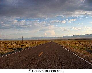 wide open road - An empty highway recedes off towards...