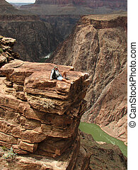 Grand Canyon rest - A woman relaxes at plateau point over...