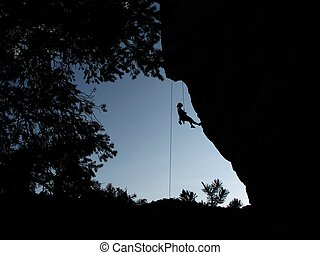 resting climber silhouette - silhouette of woman climber...