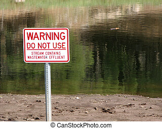wastewater warning sign - sign warning of treated wastewater...