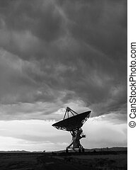 large antenna faces up - black and white image of a large...