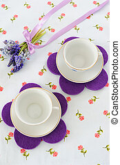 Spring Tea Party - Two cups with a bouquet of muscari on...
