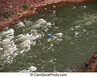 Grand Canyon rafting - blue raft on the Colorado River in...